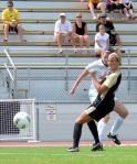 Danielle Nottingham shoots around a Purdue defender to score Missouri's third goal in the 4-2 win.