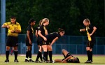 Referee Fernando Galvan pulls out a yellow card to give to Ohio State Kristin Niederhaus, as Missouri midfielder Dominique Richardson lays injured on the field as a result of the foul.  (Photo by Andrew Wamboldt)