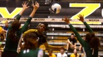Outside hitter Brittney Brimmage finds a hole in the Tulane blockers to spike the ball.  Brimmage had ten kills in the game.  (Photo by Andrew Wamboldt)