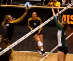 Outside hitter Lisa Henning (5) pushes the ball over the Tulane blockers.  Henning led Missouri in attacks, getting 11 kills.  (Photo by Andrew Wamboldt)