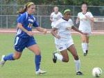 Alyssa Diggs (14) moves the ball toward the goal to take a shot, one of 32 taken by the Tigers.