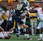 Micheal Egnew (82) fights off three Iowa State defenders. Egnew managed to shake them and keep running for a long gain.