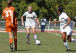 Kelsey Blincow (17) tires to work the ball to Alyssa Diggs(14) as defender Julie Arnold (37) looks on.