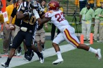 Iowa State's Leonard Johnson (23) grabs the facemask of Missouri's Henry Josey (20). Johnson was penalized on the play.