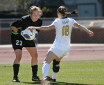 Taylor Grant (18) challenges Texas goalkeeper Alexa Gaul late in the second half, with Missouri losing 2-1.