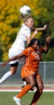 Missouri's Jessica Greer goes for the header over Texas' Vanessa Ibewuike.