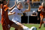 Missouri's Kaysie Clark, right, is pressured by Texas defender Julie Arnold Sunday, Oct. 2, 2011 at Walton Stadium in Columbia, Mo. Missouri scored first in the game was lost to Texas 2-1.