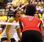 Freshman outside hitter Katie O'Brien (15) looks across the net at Texas Tech's Dravon Rangel (7). O'Brien finished second on the team in kills with 10 Saturday night, Oct. 15, 2011.