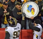 Dominique Hamilton (90) and Beau Brinkley share the Border Showdown drum with fans after beating Kansas in the yearly rivalry game.