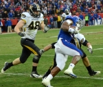 Luke Lambert (33) makes the tackle on Kansas running back James Sims (29). The Missouri defense held Kansas to 65 yards on the ground.