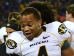 Missouri half back Kendial Lawrence (4) is all smiles as Mizzou pulled away from Kansas.