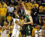 Mizzou forward Kadeem Green (15) and William & Mary's Quinn McDowell jump for a loose ball.