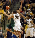Steve Moore (32) and Kadeem Green (15) defend a layup attempt by William & Mary guard Matt Rum.