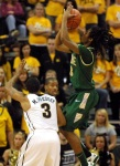 William & Mary's Marcus Thornton shoots over Matt Pressey (3) in the second half.