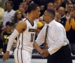 Frank Haith gives Michael Dixon a slap on the hand after the junior guard fouls out of the game late in the second half. Dixon helped MU to their first win against Texas A&M since 2004.