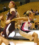 Bailey Gee (right) boxes out Kelsey Assarian (left) in the first half at Mizzou Arena. Mizzou kept Texas A&M off the glass and out-rebounded the Aggies.