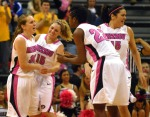 Morgan Eye (30) celebrates with Kyley Simmons (15),  BreAnna Brock (22) and Liz Smith after making a 3-point basket.