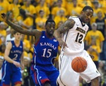 Marcus Denmon (12) chases down a loose ball in front of KU guard Elijah Johnson (15).
