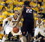 Michael Dixon guards Cowboys' swingman Markel Brown. Mizzou held Oklahoma State to 35.7 percent shooting in the first half, cruising to a 44-22 halftime lead.