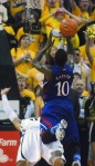 Mizzou's Michael Dixon takes a charge from Jayhawks point guard Tyshawn Taylor in the final minutes of Saturday's 74-71 victory. Dixon also made four of five shots and scored 15 points.