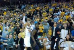 Missouri's Michael Dixon tests his range over Kansas State Victor Ojeleye and drains a 3-pointer in front of his teams' bench. Dixon led the team in scoring with 21 points and made two 3-pointers.