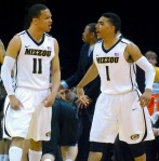 Missouri's Michal Dixon forces Kansas State guard Angel Rodriguez to turn the ball over and celebrates with Phil Pressey. This was one of two steals in the game for Dixon.