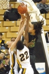 BreAnna Brock (22) and Christine Flores (left) double team Baylor's Brittney Griner. The Tigers attempted to limit Griner with double teams all game, but were unsuccessful.