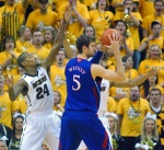 Kim English and Matt Pressey trap KU center Jeff Withey. Mizzou forced 15 Kansas turnovers Saturday at Mizzou Arena.