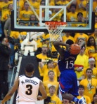 Matt Pressey watches KU's Elijah Johnson (15) slam in two of his 11 points in the second half.