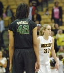 Morgan Eye (30) stands at center court for the jump-ball with Baylor's Brittney Griner (42). Coach Pingeton conceded the opening tip to Baylor due to Griner's height advantage over even the tallest Mizzou player.