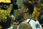 Steve Moore celebrates Mizzou's 74-71 win with fans after the game.