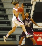 Liene Priede drives to the basket against Tyra White (20). Priede was held scoreless in 18 minutes of play.