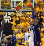 Kansas forward Thomas Robinson (0) shoots over Steve Moore. Robinson had a team-high 25 points and 13 rebounds in the losing effort.