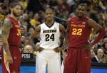 Senior Kim English stands between Iowa State's Royce White (left) and Anthony Booker (right) during Missouri free throw attempts. English finished with 13 points and eight rebounds on senior night.