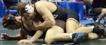 Missouri wrestler Brent Haynes tries to pin Joseph Kennedy in the sixth round of the 197 pound NCAA consolation bracket on the evening of Friday, March 16, 2012.