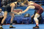 Mike Larson struggles against No. 5 Kevin Steinhaus from Minnisota in the sixth round of the 184 NCAA consolation bracket on the evening of Friday, March 16, 2012. Steinhaus won by tech fall, 17-2.