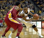 Senior Matt Pressey looks to drive to the lane on Iowa State's Tyrus McGee. Pressey played for 13 minutes in his final regular season as a Missouri Tiger.