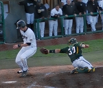 Baylor catcher Josh Ludy misses the tag and Ben Turner makes it home safely in the fifth to tie the game 1-1.