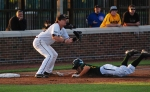 Conner Mach attempts to put out Lawton Langford in the sixth. Langford eventually made it home to regain the lead for Baylor.