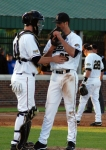 Catcher Ben Turner speaks with Blake Holovach during the sixth inning. Holovach gave up nine hits and five runs before being replaced by Dusty Ross after five and two-third innings.