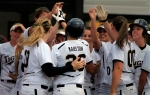 Jenna Marston is congratulated by the Missouri softball team after getting the game-winning hit on Sunday, May 13, 2012.