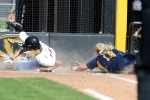 Corrin Genovese safely slides home after an Ashtin Stephens sacrifice fly in Game 1.