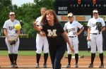 Players watch as Kathy Earleywine, mother of Missouri softball coach Ehren Earleywine, throws out the first pitch Sunday, May 13, 2012, Mother's Day.