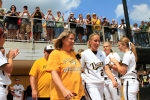 Kristin Nottelmann is honored on Senior Day and heads out to the field with her mother, Gwyn, Sunday, May 13, 2012. Behind them is Nottelmann's father, Jim.