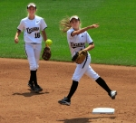 Second baseman Ashtin Stephins throws to first base for an out as shortstop Corrin Genovese looks on.