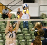 Emily Wilson grimaces as she goes for a block.