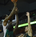 Senior forward Alex Oriakhi (left) shoots the ball over two Missouri Southern defenders during Missouri's 86-80 win Nov. 4 at Mizzou Arena. Oriakhi scored only two points but grabbed four rebounds and two blocks for Missouri.