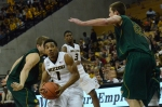 Phil Pressey drives through a crowd of Missouri Southern defenders during Missouri's 86-60 win on Nov. 4.