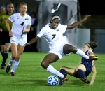 Haley Krentz (4) watches as Taiwo Adeshigbin (7) trips over an Illinois defender as Adeshigbin works toward the goal.