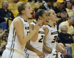 Sydney Crafton (21), Morgan Eye (30) and freshman forward Michelle Hudyn happily greet their teammates before a time-out in Thursday's game against the Southeast Missouri Redhawks. Missouri won, 80-51.